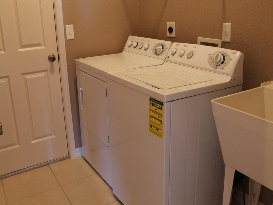 Inside Laundry Room with Washer and Dryer Included
